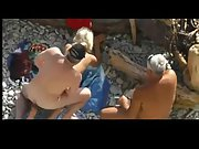 Mature naturist couple have some oral gonzo fun before enjoying public intercourse