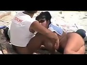 Butt naked wifey gives her powerful hubby a nice blowjob at the local beach