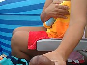 Wife masturbating rock hard cock at the beach sheltered only by wind breaks