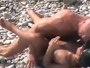 Bald guy screws his sexy babe on the beach