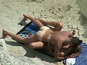 Horny duo sunbathing on a beach get excited and cannot resist fuck-a-thon
