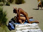 Successful spycam films nasty amateurs having beach romp